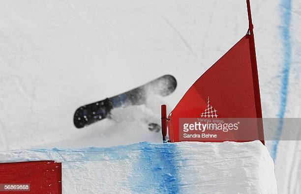 Lindsey Jacobellis of the United States falls after a jump in the Womens Snowboard Cross Final on Day 7 of the 2006 Turin Winter Olympic Games on...