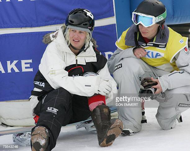 Lindsey Jacobellis of the US holds her leg after falling in her second run during the women's FIS World Cup Snowboard Halfpipe 10 March 2007 in...