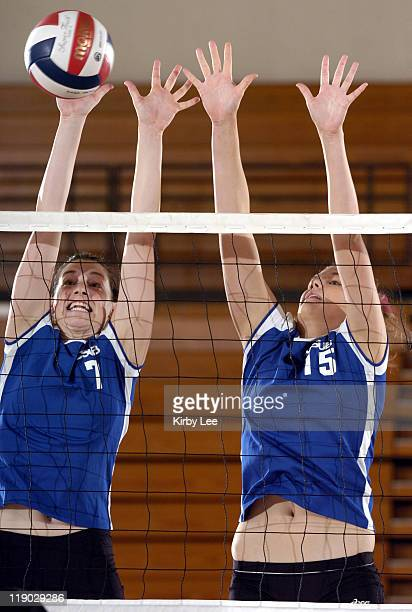 Lindsey Jordan and Melissa Myers of Cal State Bakersfield team for a block in 30-24, 21-30, 17-30, 30-27, 15-9 victory over Cal State Dominguez Hills...