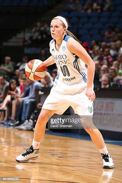 Lindsey Moore of the Minnesota Lynx dribbles the ball against the San Antonio Stars on May 30 2014 at Target Center in Minneapolis Minnesota NOTE TO...