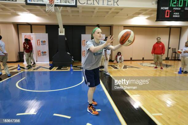 Lindsey Moore of the Minnesota Lynx hosts a WNBA FIT Dribble to Stop Diabetes clinic for local youngsters during the 2013 WNBA Finals on October 7...