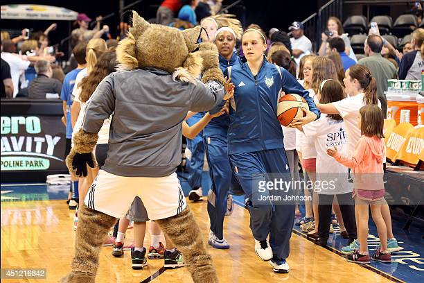 Lindsey Moore of the Minnesota Lynx runs out before the game against the Indiana Fever during the WNBA game on June 22 2014 at Target Center in...