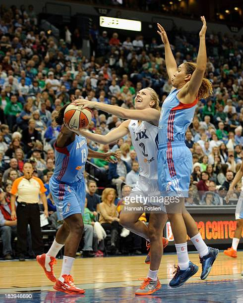Lindsey Moore of the Minnesota Lynx shoots the ball against Aneika Henry and Courtney Clements of the Atlanta Dream during Game One of the 2013 WNBA...