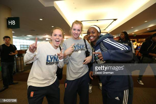 Lindsey Moore Rachel Jarry and Sugar Roger the three rookies of the 2013 WNBA Champion Minnesota Lynx pose for a picture on the concourse on October...