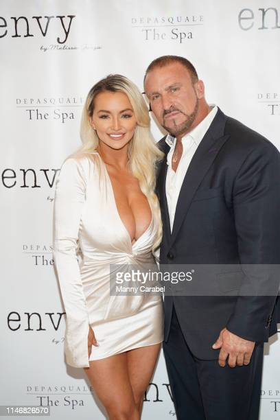 Lindsey Pelas and Frank Catania attend the Envy By Melissa Gorga Fashion Show on May 03 2019 in Hawthorne New Jersey