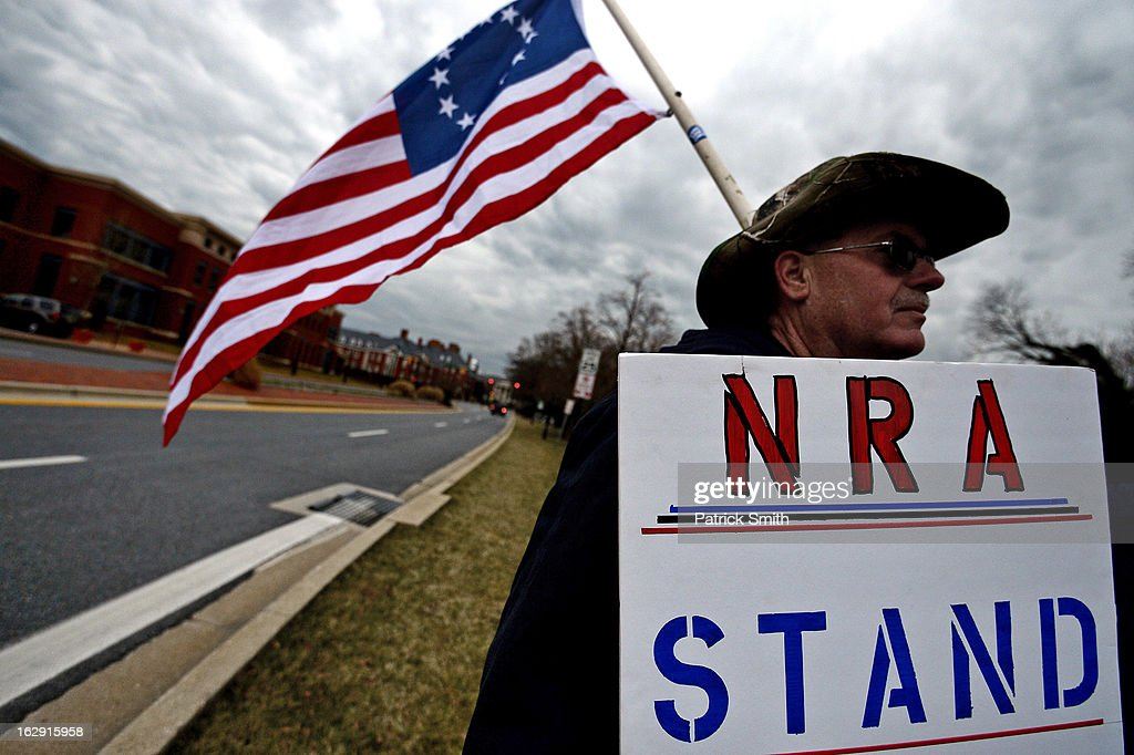 Lindsey Scott of Baltimore, MD, stands on the corner to protest advocates of stricter gun control laws, as supporters rally at the Maryland State House on March 1, 2013 in Annapolis, Maryland. Earlier this week, the Maryland Senate passed a gun control bill, which if passed in the House of Delegates, would require a license to purchase a handgun, ban the sale of assault-style rifles and limit magazine size, among other provisions.