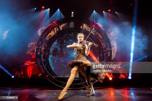 Lindsey Stirling performs on stage at Eventim Apollo on October 14 2019 in London England