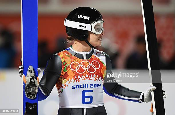 Lindsey Van of the United States looks on during the Ladies' Normal Hill Individual final round on day 4 of the Sochi 2014 Winter Olympics at the...