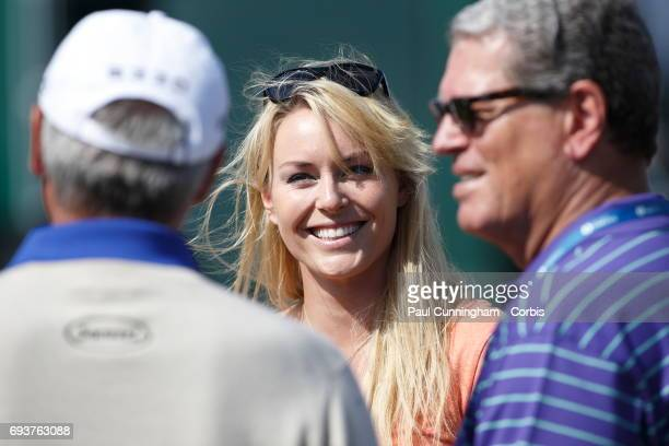 Lindsey Vonn chats with Fred Couples during the first round of The Open Championship 2013 at Muirfield Golf Club on July 17 2013 in Scotland