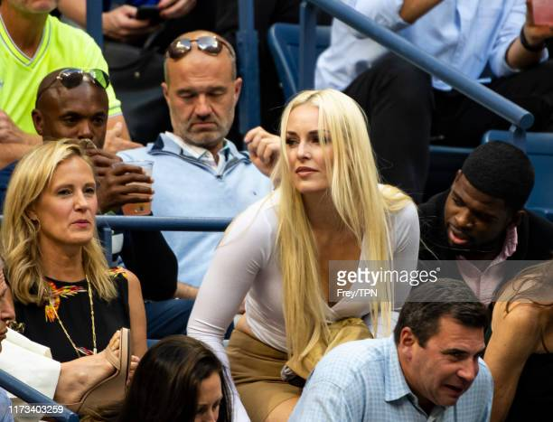 Lindsey Vonn, former World Cup alpine ski racer and partner, P.K. Subban, Nashville Predators ice hockey player watch Rafael Nadal of Spain against...