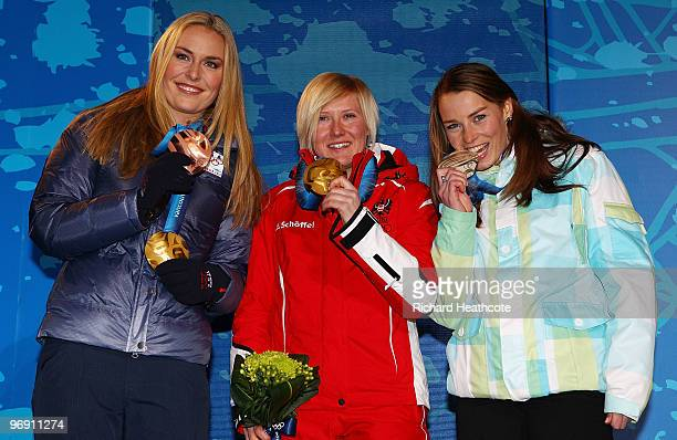 Lindsey Vonn of the United States receives the bronze medal Andrea Fischbacher of Austria receives the gold medal and Tina Maze of Slovenia receives...