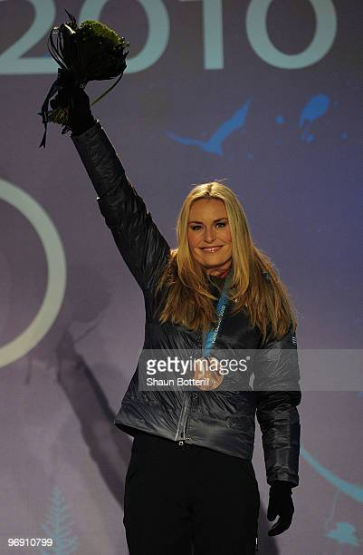 Lindsey Vonn of the United States receives the bronze medal during the medal ceremony for the women's superg alpine skiing held at the Whistler...