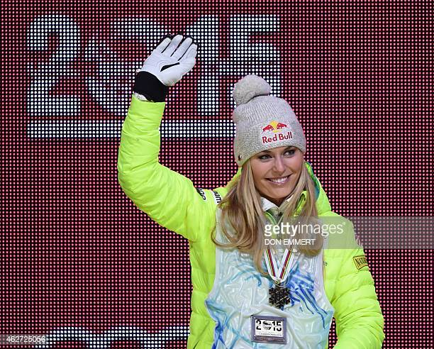 Lindsey Vonn of the US waves to the crowd as she receives her 2015 World Alpine Ski Championships women's Super G bronze medal during the awards...