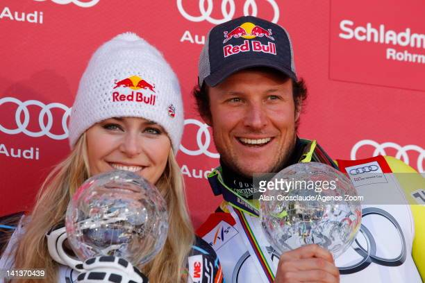 Lindsey Vonn of the USA and Aksel Lund Svindal of Norway win the Overall World Cup SuperG globes during the Audi FIS Alpine Ski World Cup Men's...