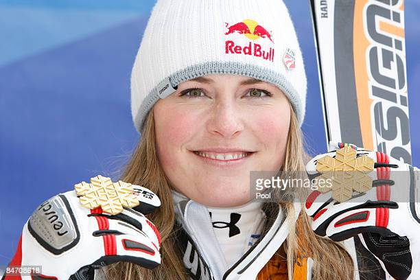 Lindsey Vonn of the USA celebrates with her gold medal as she wins the Women's Downhill event held on the Face de Solaise course on February 9 2009...