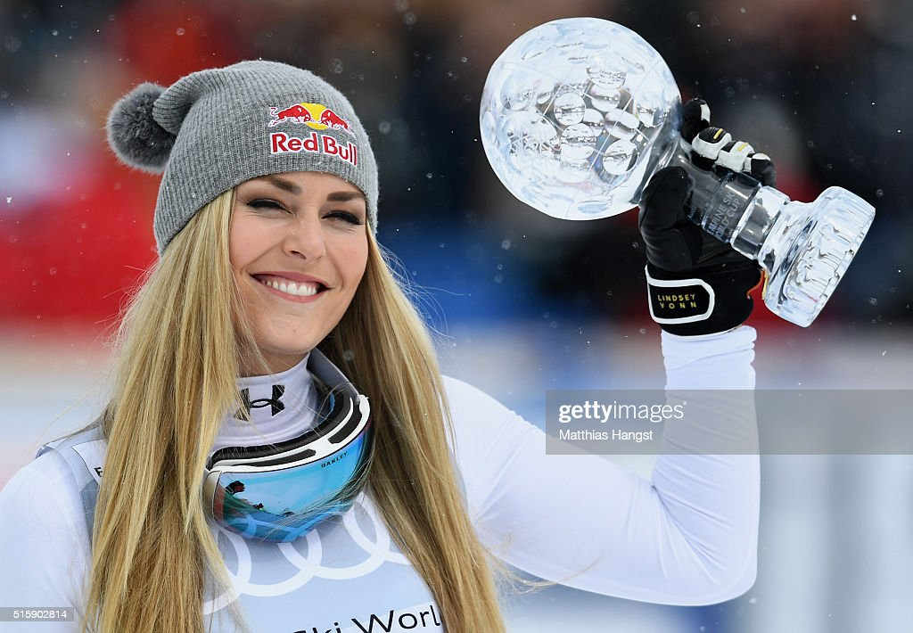 Lindsey Vonn of the USA poses with the Women's World Cup Downhill Crystal Globe trophy after the Women's Downhill Race on March 16, 2016 in St Moritz, Switzerland.