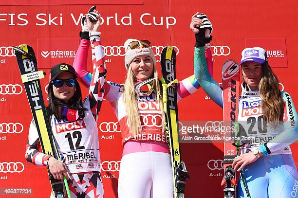 Lindsey Vonn of the USA takes 1st place and wins the overall SuperG World Cup globe Anna Fenninger of Austria takes 2nd place and Tina Maze of...