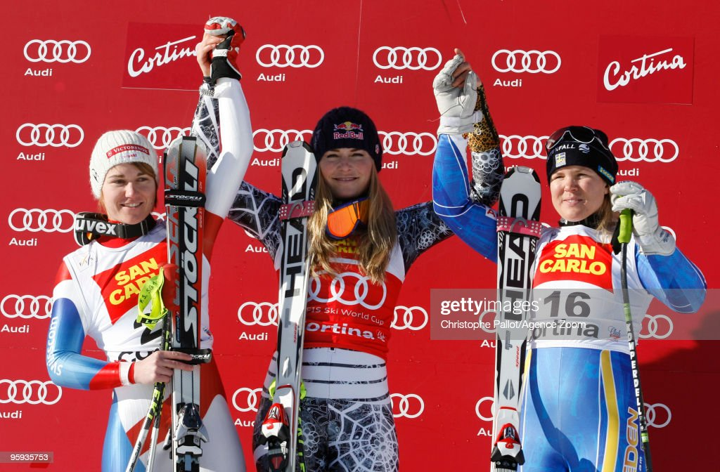 Lindsey Vonn of the USA takes 1st place, Fabienne Suter of Switzerland takes 2nd place, Anja Paerson of Sweden takes 3rd place during the Audi FIS Alpine Ski World Cup Women's Super G on January 22, 2010 in Cortina d'Ampezzo, Italy.