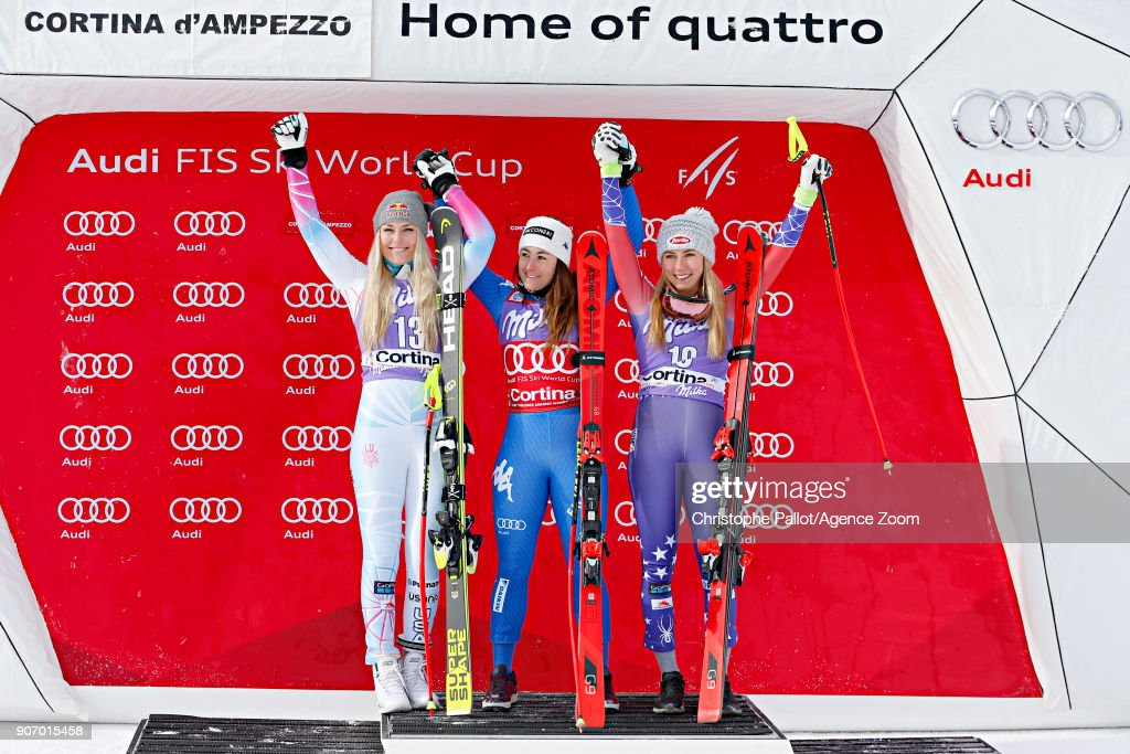 Lindsey Vonn of USA takes 2nd place, Sofia Goggia of Italy takes 1st place, Mikaela Shiffrin of USA takes 3rd place during the Audi FIS Alpine Ski World Cup Women's Downhill on January 19, 2018 in Cortina d'Ampezzo, Italy.