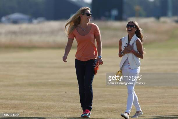 Lindsey Vonn with Fred Couples girlfriend Nadine Moze laugh out loud on the16th fairway during the first round of The Open Championship 2013 at...