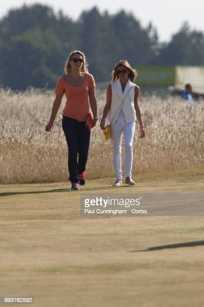 Lindsey Vonn with Fred Couples girlfriend Nadine Moze on the16th fairway during the first round of The Open Championship 2013 at Muirfield Golf Club...