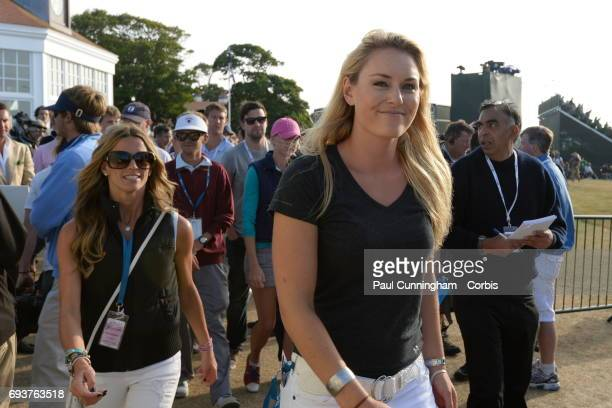 Lindsey Vonn with Nadine Moze at the 18th green and Club House at the end of Tiger Woods round during the third round of The Open Championship 2013...