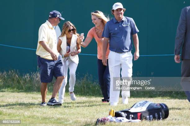 Lindsey Vonn with Nadine Moze laugh out loudly while having fun with Jason Dufner taking selfie pictures while performing the 'vacant pose' a craze...