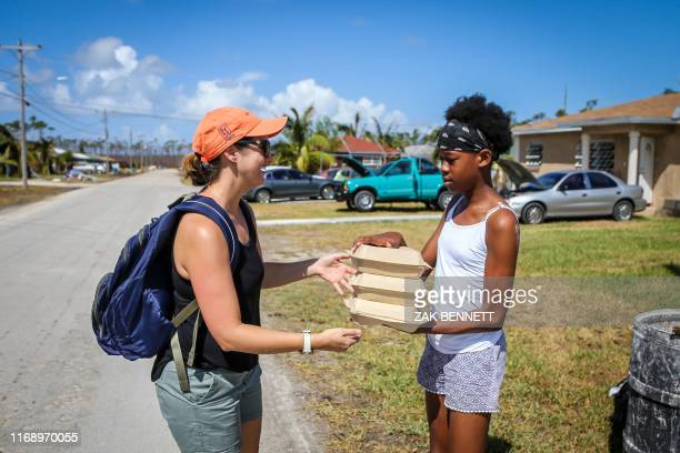 Lindsey Wiegmann of the Bahamas Paradise Cruise Line delivers three of some 20000 meals prepared for Bahamians in the aftermath of Hurricane Dorian...