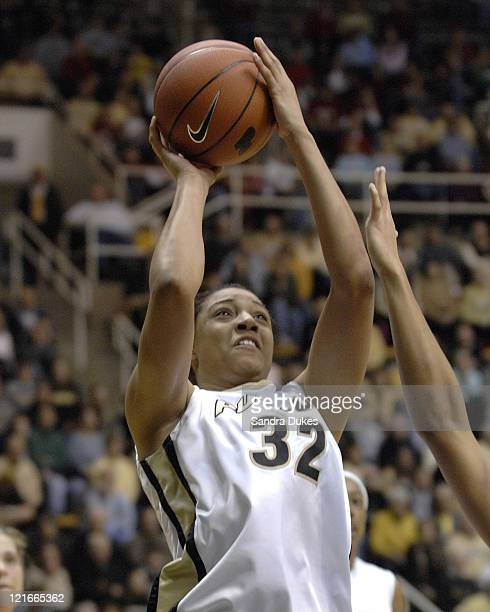 Lindsey WisdomHylton fires a shot in the game won by Purdue 7351 over Indiana in Mackey Arena West Lafayette Indiana on January 14 2007