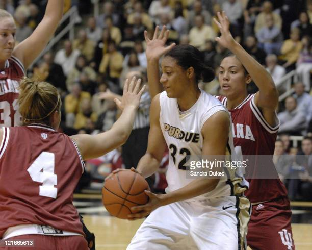 Lindsey WisdomHylton is surrounded by Indiana defenders in the game won by Purdue 7351 over Indiana in Mackey Arena West Lafayette Indiana on January...