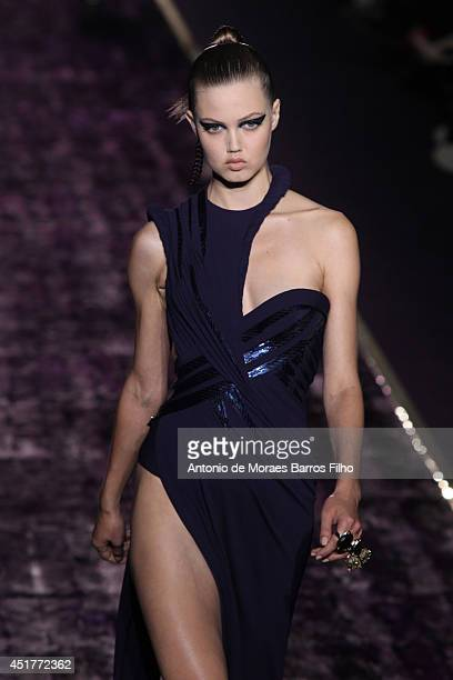 Lindsey Wixson walks the runway during the Versace show as part of Paris Fashion Week Haute Couture Fall/Winter 20142015 at on July 6 2014 in Paris...