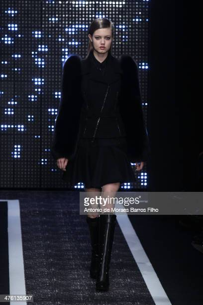 Lindsey Wixsonl walks the runway during the Maxime Simoens show as part of the Paris Fashion Week Womenswear Fall/Winter 20142015 on March 2 2014 in...