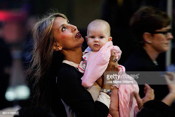 Lindt Cafe siege survivor Selina Win Pe holds a baby in her arms during the one year anniversary at Martin Place on December 15 2015 in Sydney...