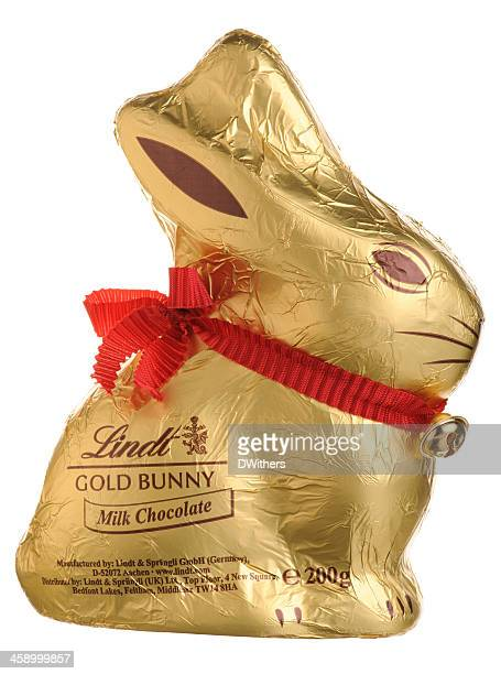 lindt easter gold bunny isolated on white - chocolate bunny stock pictures, royalty-free photos & images