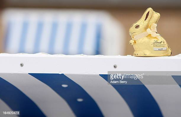Lindt Spruengli brand chocolate Easter bunny sits atop a Strandkorb or beach basket on the snowcovered Strandbad Wannsee beach during its opening for...
