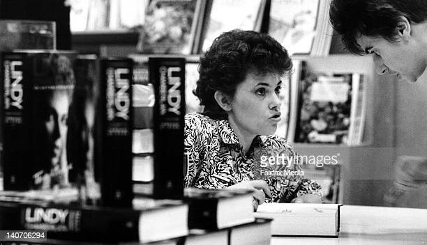 """Lindy Chamberlain autographs her new book, """"Through My Eyes"""", at the Grace Brothers department store on October 25, 1990 in Sydney,Australia. ."""