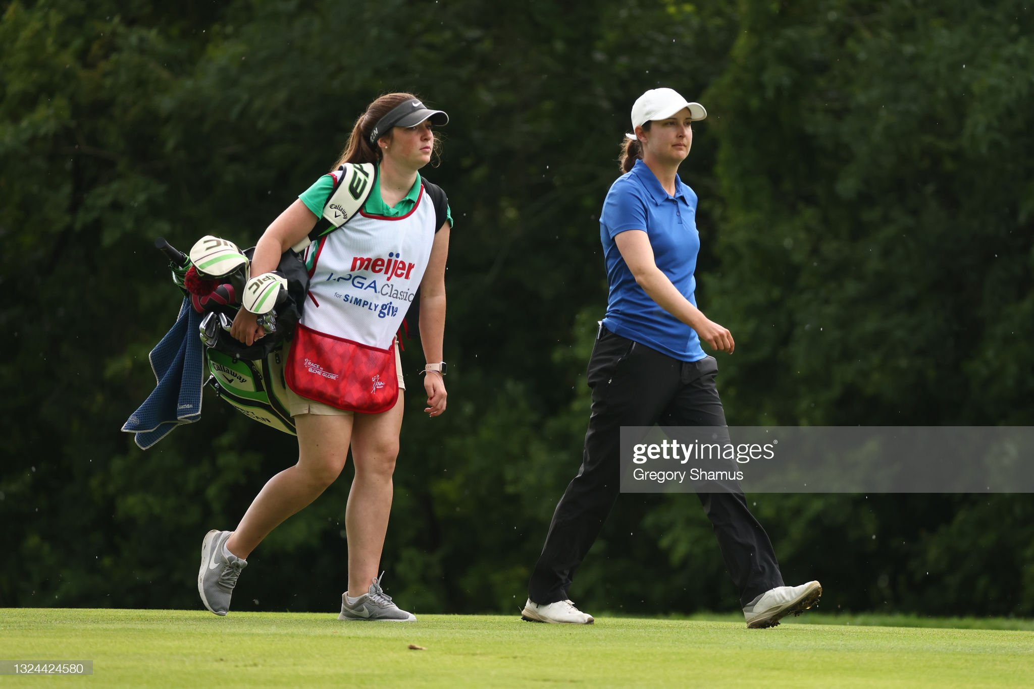 https://media.gettyimages.com/photos/lindy-duncan-walks-with-her-caddie-on-the-10th-hole-during-round-of-picture-id1324424580?s=2048x2048