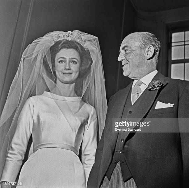 Lindy Guinness with her father, politician and businessman Loel Guinness during her wedding to Sheridan Hamilton-Temple-Blackwood, 5th Marquess of...