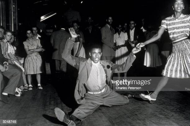Lindy Hoppers swing dancing in the Savoy Ballroom in Harlem New York City