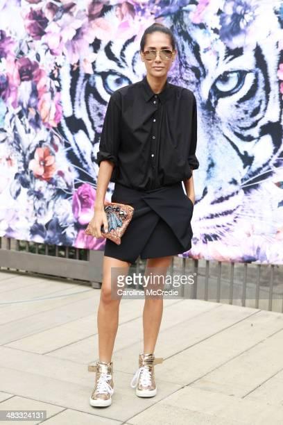 Lindy Klim wearing Ellery skirt, Maui handbag, Pierre Hardy shoes and Acme shirt at Mercedes-Benz Fashion Week Australia 2014 at Carriageworks on...