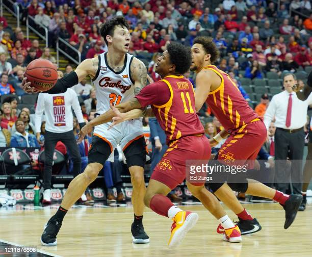 Lindy Waters III of the Oklahoma State Cowboys looks to pass against Prentiss Nixon and George Conditt IV of the Iowa State Cyclones in the first...