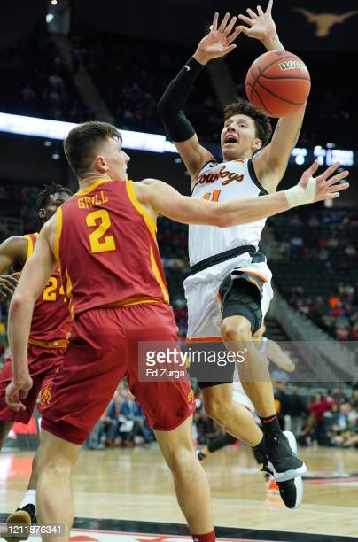 Lindy Waters III of the Oklahoma State Cowboys loses the ball against Caleb Grill of the Iowa State Cyclones the first half during the first round of...