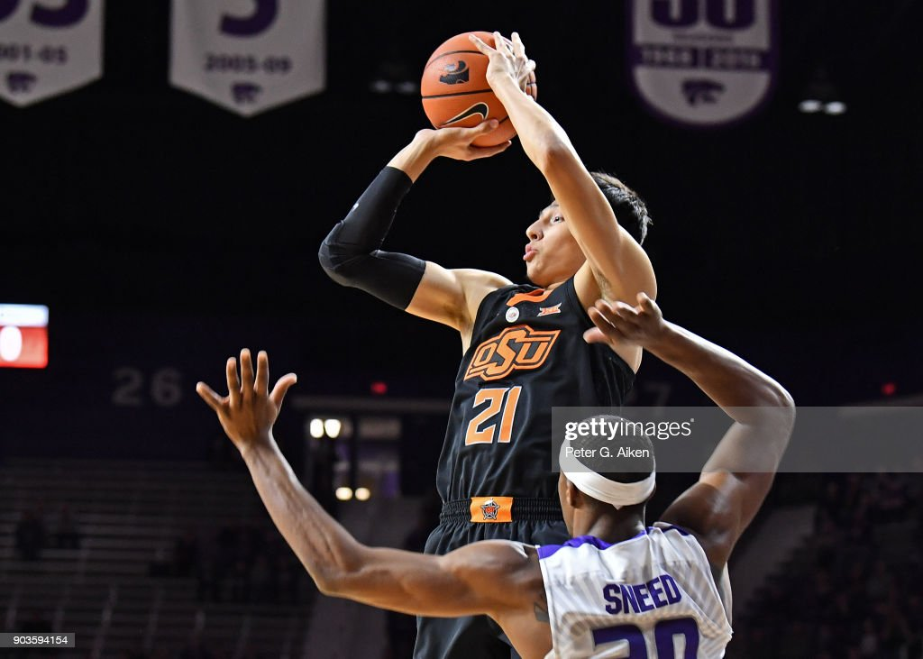 Lindy Waters III #21 of the Oklahoma State Cowboys puts up a shot against Xavier Sneed #20 of the Kansas State Wildcats during the first half on January 10, 2018 at Bramlage Coliseum in Manhattan, Kansas.