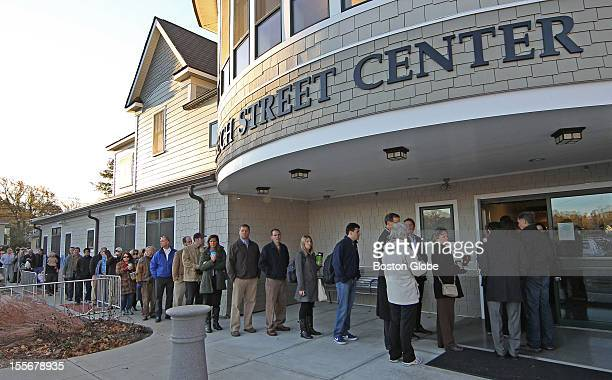 A line around the Beech Street Center had voters lined up in the early morning before Mitt Romney and his wife Ann Romney came there to vote on...