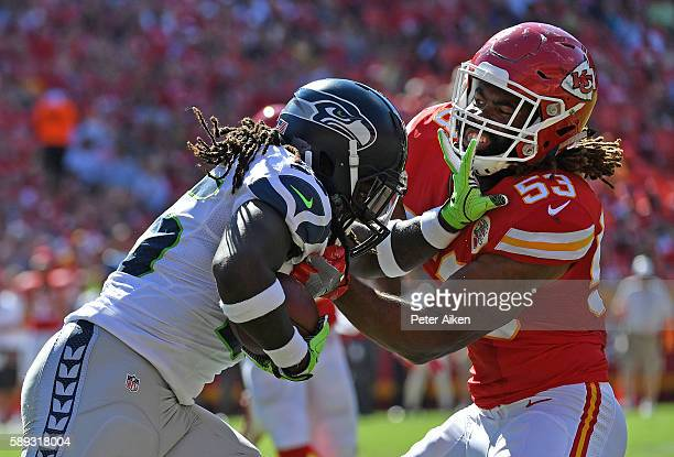 Line backer Ramik Wilson of the Kansas City Chiefs tackles running back Alex Collins of the Seattle Seahawks during the first half on August 13 2016...