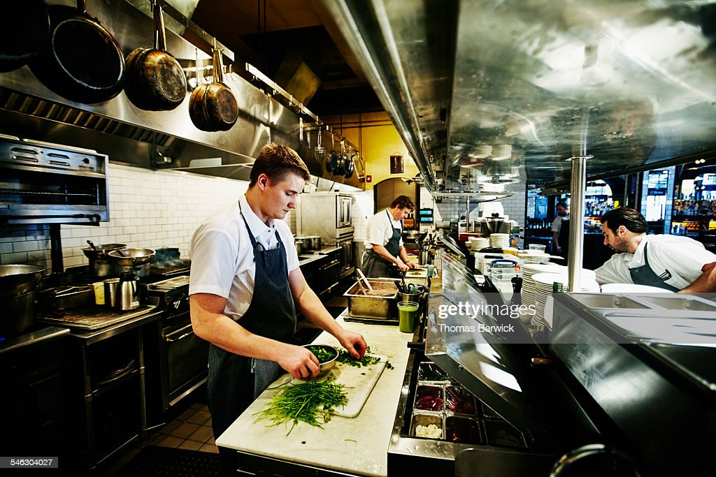 Line Cook Preparing Cilantro In Restaurant Kitchen : Stock Photo