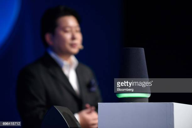 A Line Corp Wave smart speaker sits on display while Jun Masuda chief strategy and marketing officer speaks during the companys annual strategy...
