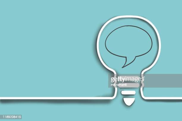 line drawing of a light bulb with a speech bubble - speech stock pictures, royalty-free photos & images
