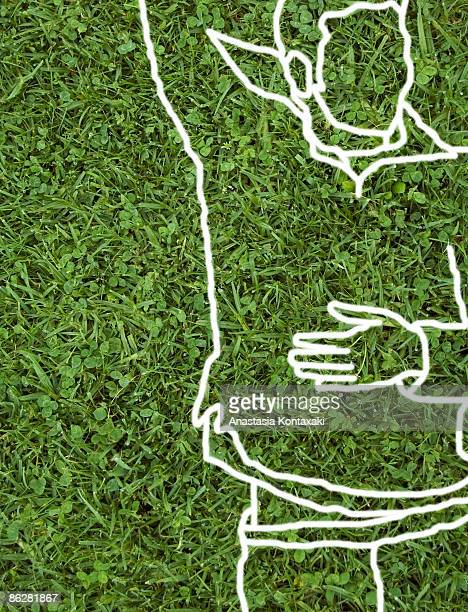 Line drawing of man lying on grass