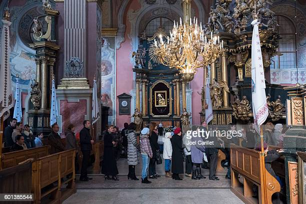 Line for communion at St. Andrew's church in Lviv, Ukraine